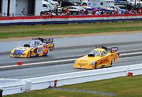 May 15, 2011; Commerce, GA, USA: NHRA funny car driver Jeff Arend (right) races alongside Ron Capps during the Southern Nationals at Atlanta Dragway. Mandatory Credit: Mark J. Rebilas-