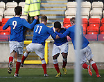 Junior Ogen smobbed after scoring goal no 2 for Rangers