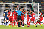 Players of Oman protest to FIFA Referee Mohd Amirul Izwan of Malaysia (C) during the AFC Asian Cup UAE 2019 Group F match between Oman (OMA) and Japan (JPN) at Zayed Sports City Stadium on 13 January 2019 in Abu Dhabi, United Arab Emirates. Photo by Marcio Rodrigo Machado / Power Sport Images