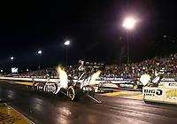 Jul. 26, 2013; Sonoma, CA, USA: NHRA top fuel dragster driver Shawn Langdon (left) races alongside Tommy Johnson Jr during qualifying for the Sonoma Nationals at Sonoma Raceway. Mandatory Credit: Mark J. Rebilas-