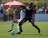 Han Duan (left) and Kandace Wilson (9) battle for the ball. Los Angeles Sol defeated FC Gold Pride 2-0 at Buck Shaw Stadium in Santa Clara, California on May 24, 2009.