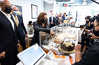 United States Vice President Kamala Harris (C) orders pieces of cake while standing with US Senator Cory Booker (Democrat of New Jersey) (L) and Governor Phil Murphy (Democrat of New Jersey) (2-L) at the bakery Tonnie's Minis during an off-the-record stop as part of Harris' one-day visit to the state in Newark, New Jersey, USA, 08 October 2021.<br /> CAP/MPI/RS<br /> ©RS/MPI/Capital Pictures