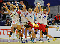 BELGRADE, SERBIA - DECEMBER 16: Norway players try to block shoot of Milena Knezevic of Montenegro (R) during the Women's European Handball Championship 2012 gold medal match between Norway and Montenegro at Arena Hall on December 16, 2012 in Belgrade, Serbia. (Photo by Srdjan Stevanovic/Getty Images)