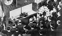 1968 FILE PHOTO - ARCHIVES -<br /> <br /> Mourning members of the Quebec cabinet gather round the casket of their late leader as Quebec today began its formal mourning for Daniel Johnson, who died in his sleep yesterday. Mrs. Johnson was there to firmly shake hands and accept condolences from her husband's friends. The premier, in black suit, lay with hands folded across his chest with bouquet of red from his family beside him.<br /> <br /> 1968<br /> <br /> PHOTO : Graham Bezant - Toronto Star Archives - AQP