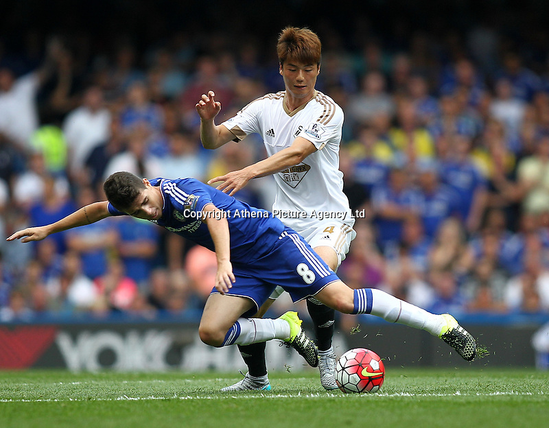 Ki Sung-yueng of Swansea battles with Oscar of Chelsea   during the Barclays Premier League match between  Chelsea and Swansea  played at Stamford Bridge, London