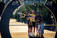 Tadej Pogacar (SVN/UAE-Emirates) on the podium in Paris as the winner of the yellow jersey as GC winner in this Tour and joined by runner-up Jonas Vingegaard (DEN/Jumbo-Visma) & 3rd finisher Richard Carapaz (ECU/INEOS Grenadiers) ....and their kids!<br /> <br /> Stage 21 (Final) from Chatou to Paris - Champs-Élysées (108km)<br /> 108th Tour de France 2021 (2.UWT)<br /> <br /> ©kramon