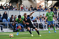 SAN JOSE, CA - SEPTEMBER 29: Xavier Arreaga #25 of the Seattle Sounders FC battles Tommy Thompson #22 of the San Jose Earthquakes for the ball during a Major League Soccer (MLS) match between the San Jose Earthquakes and the Seattle Sounders on September 29, 2019 at Avaya Stadium in San Jose, California.