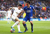 Jack Cork of Swansea City and Shinji Okazaki of Leicester City during the Barclays Premier League match between Leicester City and Swansea City played at The King Power Stadium, Leicester on April 24th 2016