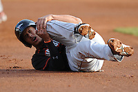 Delmarva Shorebirds Manny Machado #21 goes down with a knee injury in the first inning during  a game against  the  Asheville Tourists at McCormick Field in Asheville,  North Carolina;  May 5, 2011. Photo By Tony Farlow/Four Seam Images
