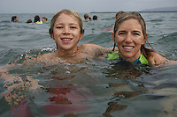 August 17 2015, Ocean Beach San Diego CA USA: San Diego Junior Lifeguard Jacob Adler and his mother Danielle pose after a giant leap from the Ocean Beach Pier into the turbulent waters below.  The twice annual San Diego tradition is the culmination of weeks of training by the young guards, aged 9 to 16 years old.