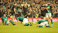 Saturday 17th November 2018 | Ireland vs New Zealand<br /> <br /> Josh van der Flier hugs TJ Perenara at the final whistle as exhauster Irish and New Zealand players litter the ground during 2018 Guinness Series between Ireland and Argentina at the Aviva Stadium, Lansdowne Road, Dublin, Ireland. Photo by John Dickson / DICKSONDIGITAL