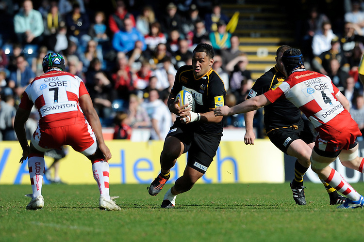Billy Vunipola of London Wasps runs into Akapusi Qera (left) and Tom Savage of Gloucester Rugby during the Aviva Premiership match between London Wasps and Gloucester Rugby at Adams Park on Sunday 1st April 2012 (Photo by Rob Munro)