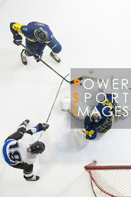 Verity Team Goalkeeper #33 Sam Wong (right) defends his goal against Gaggia Empire Skater #18 Gary Hon (left) during the match Gaggia Empire vs Verity, a match part of the Principal Standard League on 07 March 2017 in Mega Ice, Hong Kong, China. Photo by Marcio Rodrigo Machado / Power Sport Images