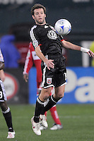 DC United midfielder Ben Olsen (14) chest the ball.  Chicago Fire tied DC United 1-1 at  RFK Stadium, Saturday March 28, 2009.