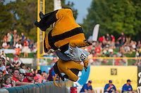 Bumble, the Salt Lake Bees mascot flips during the game against the Iowa Cubs in Pacific Coast League action at Smith's Ballpark on August 21, 2015 in Salt Lake City, Utah. The Bees defeated the Cubs 12-8.  (Stephen Smith/Four Seam Images)