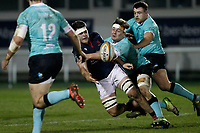 Lewis Wynne of London Scottish offloading the ball during the Greene King IPA Championship match between London Scottish Football Club and Nottingham Rugby at Richmond Athletic Ground, Richmond, United Kingdom on 7 February 2020. Photo by Carlton Myrie.