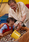 Early intervention occupational therapy 9 moth old girl developmental delay,sensory activity w. bean box vertical
