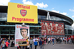 Arsenal 6 Olympique Lyonnais 0, Villarreal 2 Wolfsburg 1, 25/08/2015. Emirates Stadium, Emirates Cup. Programme sales outside the stadium. Two games for the price of one as some of Europe's finest arrive in London for the Emirates Cup, giving supporters the chance to experience a day out free of the usual worries that accompany a Premier League match. Photo by Simon Gill.