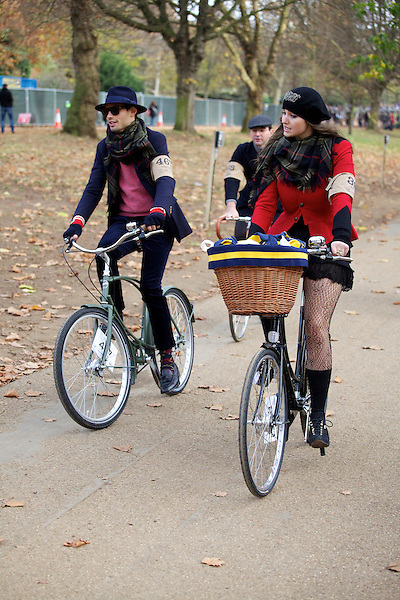 Mark-Francis Vandelli and Gabilicious from Made in Chelsea ride their bicycles during The Tweed Run, London
