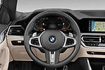 Car pictures of steering wheel view of a 2021 BMW 4-Series M-Sport 2 Door Convertible Steering Wheel