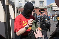 Moscow, Russia, 01/05/2006..Police search a member of Red Youth Vanguard as he passes through a metal detector in Moscow city centre. A variety of political groups took to the streets on the traditional Mayday holiday.