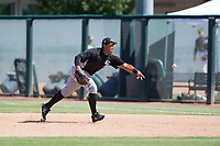 Chicago White Sox first baseman Harvin Mendoza (23) flips to the pitcher covering first base during an Instructional League game against the Oakland Athletics at Lew Wolff Training Complex on October 5, 2018 in Mesa, Arizona. (Zachary Lucy/Four Seam Images)