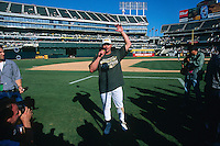 OAKLAND, CA - Jason Giambi of the Oakland Athletics talks to the fans after the A's clinched the American League Western Division title after a game at the Oakland Coliseum in Oakland, California in 2000. Photo by Brad Mangin