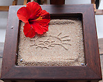 The Siladen Resort symbol is impressed into sand in trays and receptacles around the reception area at the Siladen Resort and Spa, on Siladen Island, off North Sulawesi, Indonesia.