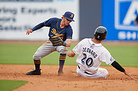 Montgomery Biscuits second baseman Miles Mastrobuoni (5) tags Patrick Leonard (20) out on a stolen base attempt during a Southern League game against the Biloxi Shuckers on May 8, 2019 at MGM Park in Biloxi, Mississippi.  Biloxi defeated Montgomery 4-2.  (Mike Janes/Four Seam Images)