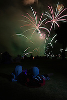 July03,2009, San Diego, California, USA:  Crowds watch an earlier Fourth of July fireworks display from San Diego's Mission Bay Park on July 3rd 2009.  The fireworks display lasted 30 minutes and drew cheers and applause from the hundreds of San Diegans crowded into the park next to the Paradise Point Resort & Spa.