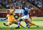 Motherwell v St Johnstone...11.08.12.Nigel Hasselbaink is denied by Ben Hutchinson.Picture by Graeme Hart..Copyright Perthshire Picture Agency.Tel: 01738 623350  Mobile: 07990 594431