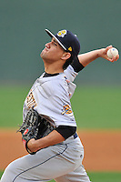 Starting pitcher Luis Cedeno (5) of the Charleston RiverDogs delivers a pitch in a game against the Greenville Drive on Tuesday May 17, 2016, at Fluor Field at the West End in Greenville, South Carolina. Greenville won, 4-2. (Tom Priddy/Four Seam Images)