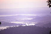 Para State, Brazil. Stunning early morning vista over the misty rainforest in dawn light; Serra dos Carajas.