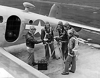 Students receiving familiarization with flight photography at Chevalier Field.  Shown here with Cine special 16mm camera, boarding SNB for movie hop. Picture taken at South Line. Instructor is W. R. James, PhoM 2/c.