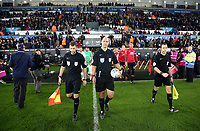 Match referee Robert Madley (C) with assistants exit the tunnel during the Carabao Cup Fourth Round match between Swansea City and Manchester United at The Liberty Stadium, Swansea, Wales, UK. Tuesday 24 October 2017