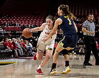 COLLEGE PARK, MD - DECEMBER 28: Taylor Mikesell #11 of Maryland powers past Amy Dilk #1 of Michigan. during a game between University of Michigan and University of Maryland at Xfinity Center on December 28, 2019 in College Park, Maryland.