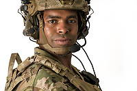 African American US military soldier in uniform in the studio with white background. For sale as stock photography, DOD complient.