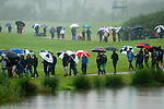 3rd June 2012 - Celtic Manor Resort - Newport - South Wales - UK :   Spectators shelter from the rain during the final day of the ISPS Handa Wales Open Golf Tournament at the Celtic Manor Resort..