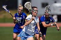 Jenn Russell (9) of North Carolina is defended by Danielle Kachulis (3) of Duke during the ACC women's lacrosse tournament semifinals in College Park, MD.  North Carolina defeated Duke, 14-4.