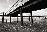 Two people on boardwalk. Sea Girt, NJ<br />