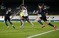 13th March 2021, Craven Cottage, London, England;  Fulhams Antonee Robinson breaks past Joh n Stones during the English Premier League match between Fulham and Manchester City at Craven Cottage in London