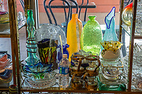 Miami, Florida.  Antique Glassware on Display in the Cubaocho Museum, Little Havana.