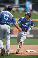 West Michigan Whitecaps catcher Brady Policelli (6) is congratulated by manager Lance Parrish (13) as he rounds third base after hitting a home run in the top of the fifth inning during a game against the Quad Cities River Bandits on July 23, 2018 at Modern Woodmen Park in Davenport, Iowa.  Quad Cities defeated West Michigan 7-4.  (Mike Janes/Four Seam Images)