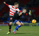 Doncaster Rovers v Middlesborough<br /> 1.2.2014<br /> Sky Bet Championship<br /> Picture Shaun Flannery/Trevor Smith Photography<br /> Middlesborough Emmanuel Ledesma holds off Rovers James Husband.