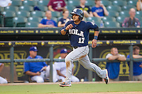 New Orleans Zephyrs third baseman Donovan Solano (17) rounds third base headed home during the Pacific Coast League baseball game against the Round Rock Express on June 30, 2013 at the Dell Diamond in Round Rock, Texas. Round Rock defeated New Orleans 5-1. (Andrew Woolley/Four Seam Images)