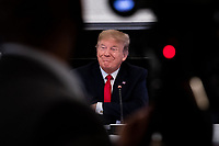 United States President Donald J. Trump listens during a roundtable discussion with industry leaders on reopening the American economy in the State Dining Room of the White House in Washington, DC on May 29, 2020. <br /> Credit: Erin Schaff / Pool via CNP/AdMedia