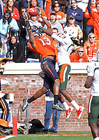 Oct 30, 2010; Charlottesville, VA, USA;  Virginia Cavaliers cornerback Chase Minnifield (13) intercepts a ball intended for Miami Hurricanes wide receiver Travis Benjamin (3)  during the game at Scott Stadium. Virginia won 24-19. Mandatory Credit: Andrew Shurtleff