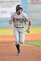 Charleston RiverDogs left fielder Michael O'Neill #10 runs to third during a game against the Asheville Tourists at McCormick Field July 26, 2014 in Asheville, North Carolina. The RiverDogs defeated the Tourists 8-7. (Tony Farlow/Four Seam Images)