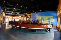 """The Antique Boat Museum: the gold cupper """"Baby Watercar"""" on display in the entry hall."""