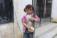 A Tibetan girl in a village in the region of Aba. South-east Tibetan Plateau, in Sichuan Province, western China.